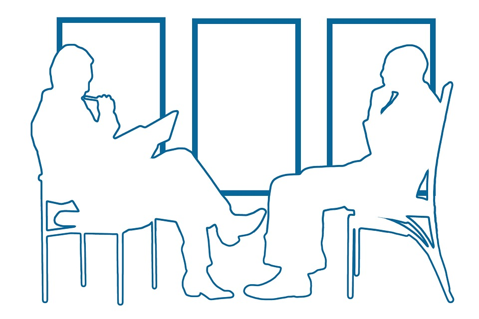 outline of two people in speaking interview