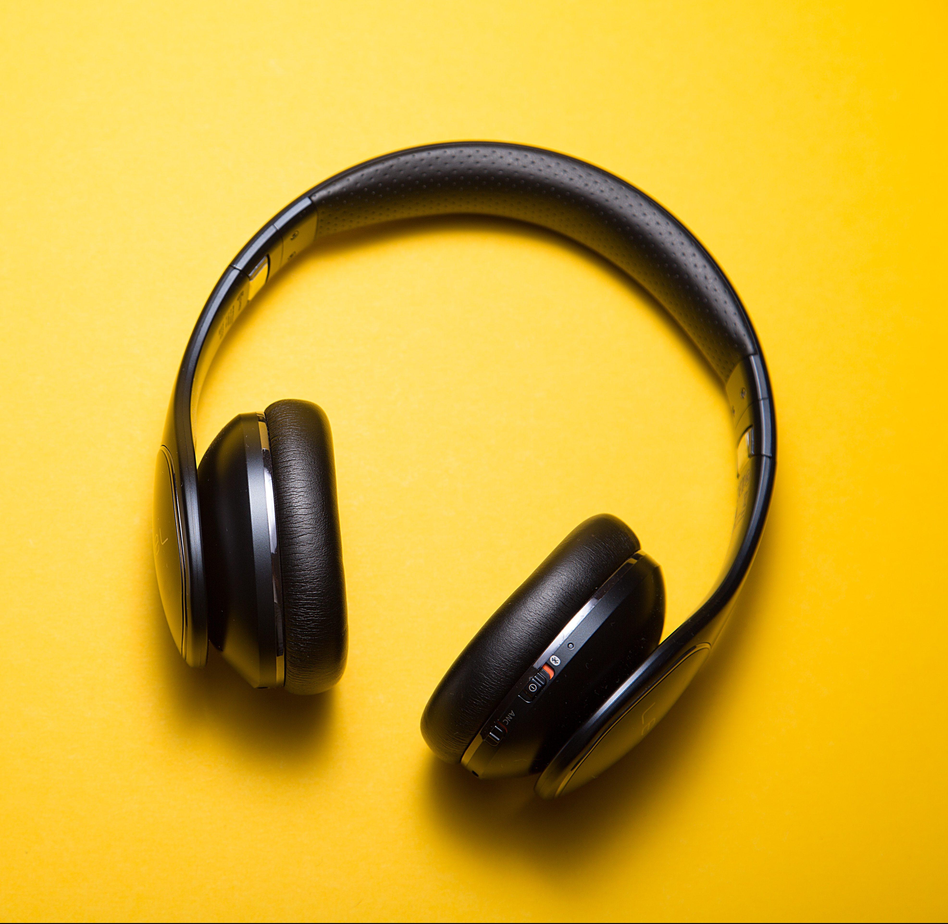 headphones yellow background